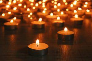 bigstock-Burning-candles-on-dark-backgr-46735477