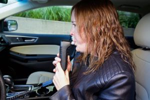 this is a woman blowing into a car breathalyzer